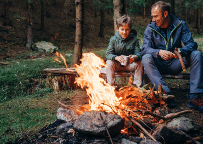father-and-son-enjoying-campfire-alberta-campgrounds